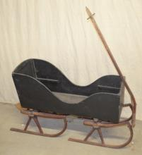 Vintage Child's Pull Sleigh with Curled Runners: It is painted a grayish-blue and has red runners. Sleigh - 23 1/2