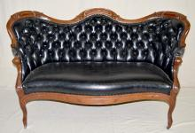 Victorian Style Wing Back Tufted Sette, walnut leaf and bead frame, black leather/vinyl material.