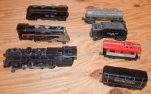 7 Assorted Train Cars: 3 Engines; 1 Caboose; Lionel Lines Tender; Tanker Car and Other. All sell as is, where is.