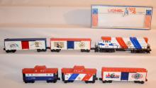 6 Piece Lionel Trains Spirit of '76 U36B Diesel No. 6-1776 with 3 Freight Cars and 2 Cabooses: Sells as is, where is.