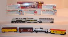 7 Piece Lionel Trains Train Set with Union Pacific Engine, #8002; Tank Car #UP9347; 2 UP Rolling Stock Cars #UP9419 and UP9366; 2 Refrigerated Freight Carriers, UP9368 & PFE; & 9811 Pacific Fruit Express Car.