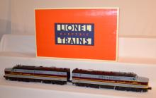 2 Piece Lionel Electric Train Set: Erie - Lackawanna PA 1A - A Set with 2 Engines, #858 and 589. In the Original Box. Sells as is, where is.