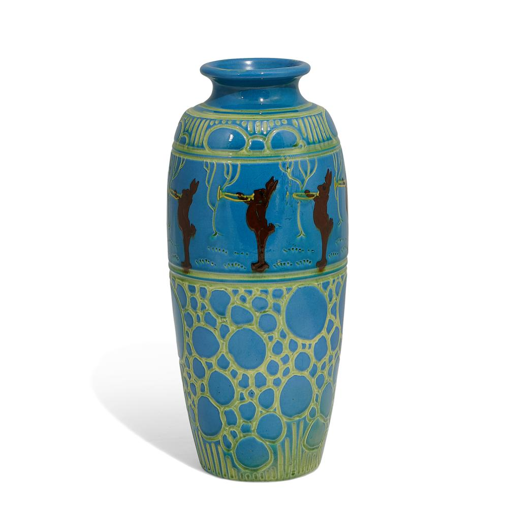 """Weller Pottery Co. large Rhead Faience earthenware vase with incised circles and eight trumpet blowing rabbits 6 1/2""""dia x 15 5/8""""h"""