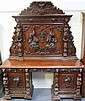A large late 19th Century oak sideboard, profusely