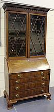 A George III mahogany bureau bookcase, the drop