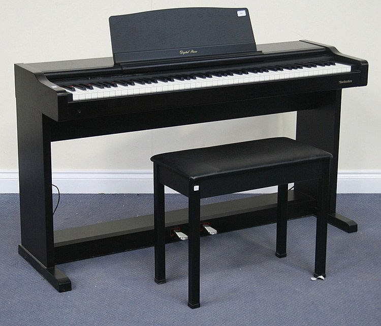 a technics pcm digital piano px44 within a black. Black Bedroom Furniture Sets. Home Design Ideas