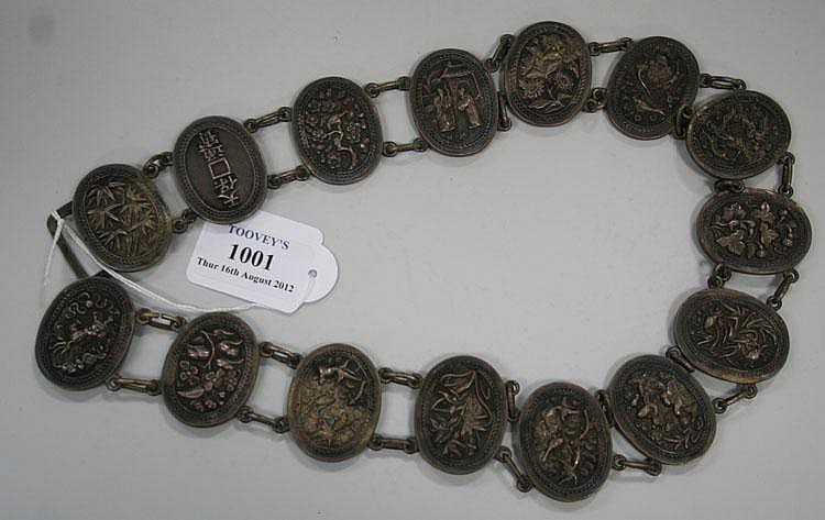 A Chinese silver oval link belt, late 19th