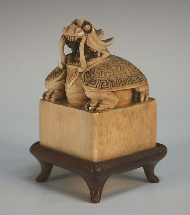 A Chinese carved ivory seal, 20th Century,