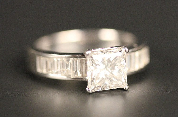 A diamond ring, mounted with the principal