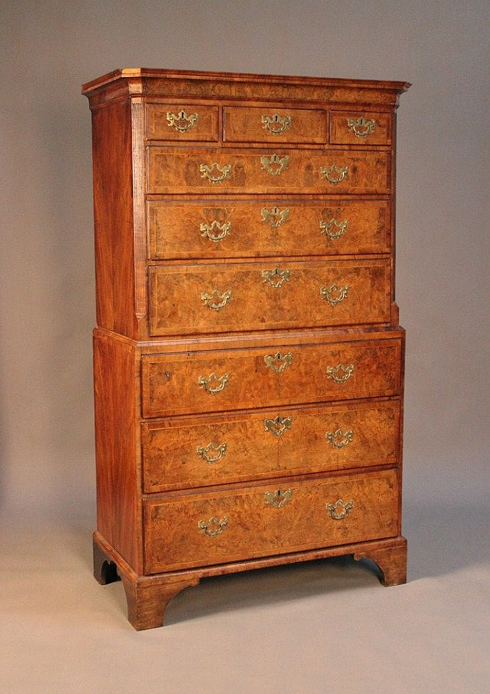 A George I burr walnut chest-on-chest, the cavetto