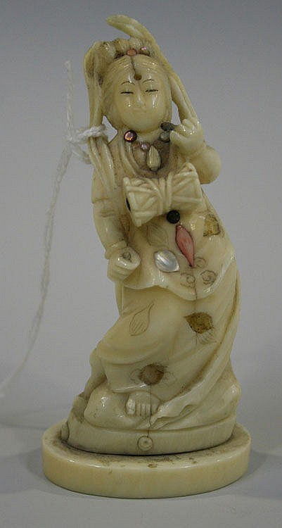 A Japanese carved ivory figure of a maiden, Meiji
