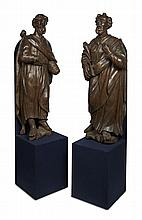 TWO LARGE CONTINENTAL CARVED OAK FIGURES OF SAINTS 17TH CENTURY One: 150cm high, 214cm overall; the other: 148cm high, 210cm overall