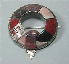 A Scottish white metal mounted agate brooch Diameter: 4.5cm