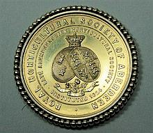 A silver gilt Royal Horticultural Society of Aberdeen medallion 4.5cm diameter, 30.8g