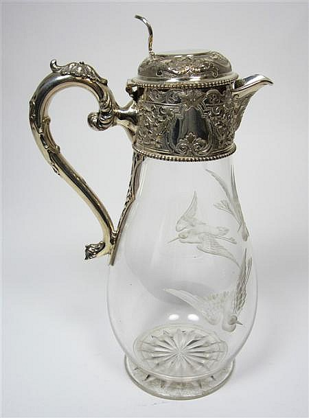 A late Victorian silver plated and engraved glass claret jug 28cm high