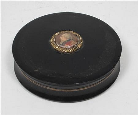 An ebonite snuff box 7.5cm diameter