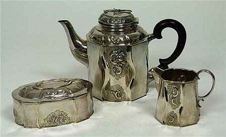 An American three piece tea set Teapot 16cm high, combined weight 29.5oz