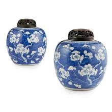 PAIR OF 'CRACKED ICE AND PRUNUS' GINGER JARS AND WOOD COVERS KANGXI MARK AND POSSIBLY OF THE PERIOD 20cm high (overall)