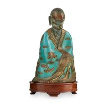 CHAMPLEVÉ ENAMEL AND BRONZE MODEL OF A LUOHAN QING DYNASTY, 18TH/19TH CENTURY 17cm high (excluding stand)