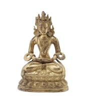 GILT BRONZE FIGURE OF AMITAYUS TIBET, LATE 19TH/EARLY 20TH CENTURY 15cm high