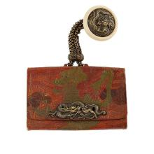<sup>Y</sup> LEATHER TABAKO-IRE (TOBACCO POUCH) WITH A METAL KAGAMIBUTA-NETSUKE MEIJI PERIOD 13.5cm wide