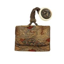 <sup>Y</sup> CREWEL TOBACCO POUCH WITH A KAGAMIBUTA-NETSUKE, TABAKO-IRE MEIJI PERIOD 11.8cm wide