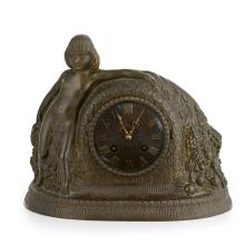 [§] GUSTAVE GILLOT (FRENCH, 1888–1965), AFTER PAUL FOLLOT ART DECO BRONZE MANTEL CLOCK, CIRCA 1925 23cm high