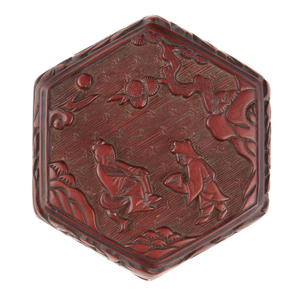 Lot 15: SMALL CARVED CINNABAR LACQUER HEXAGONAL BOX POSSIBLY MING DYNASTY 6.5cm high