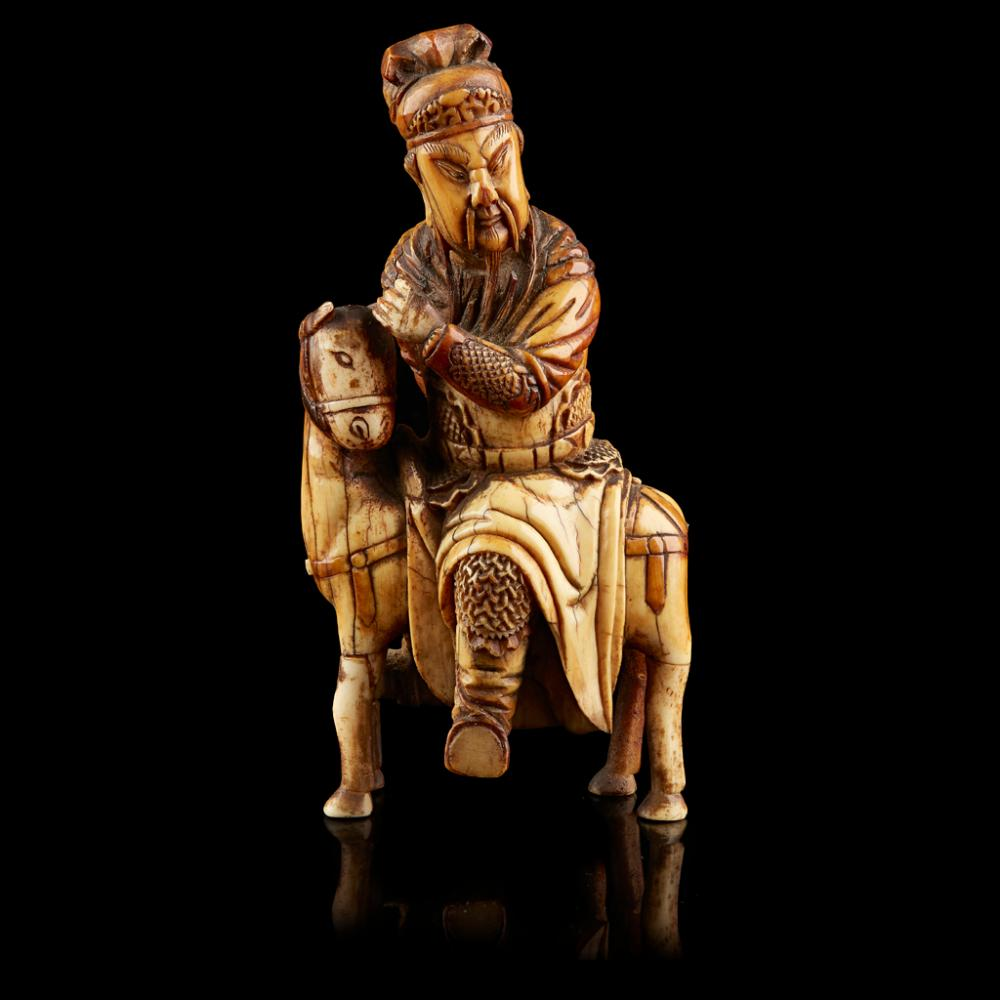 <sup>Y</sup> CARVED IVORY EQUESTRIAN FIGURE OF GUANDI MING DYNASTY 12cm high