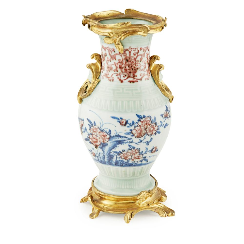 ORMOLU-MOUNTED IRON-RED AND UNDERGLAZE-BLUE DECORATED CELADON-GROUND VASE QIANLONG MARK AND OF THE PERIOD 30cm high (overall)