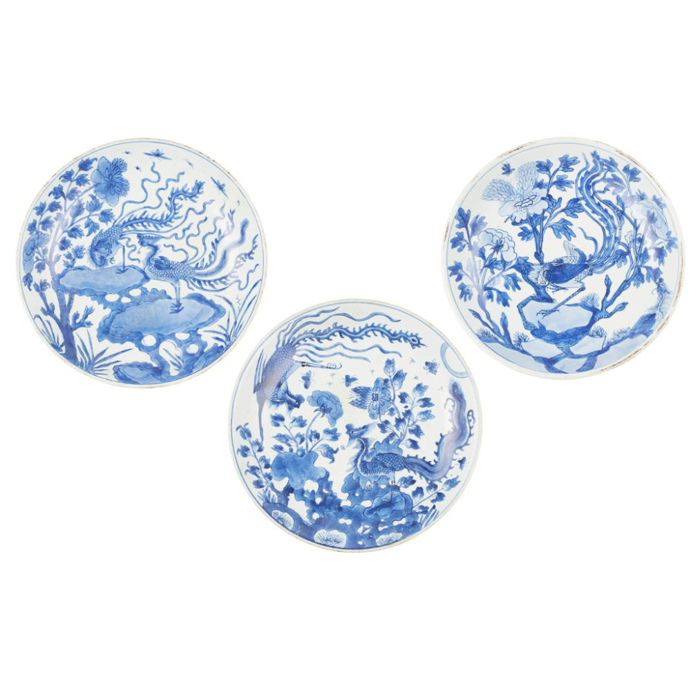 THREE BLUE AND WHITE 'PHOENIX' DISHES EARLY KANGXI PERIOD largest 35cm diameter