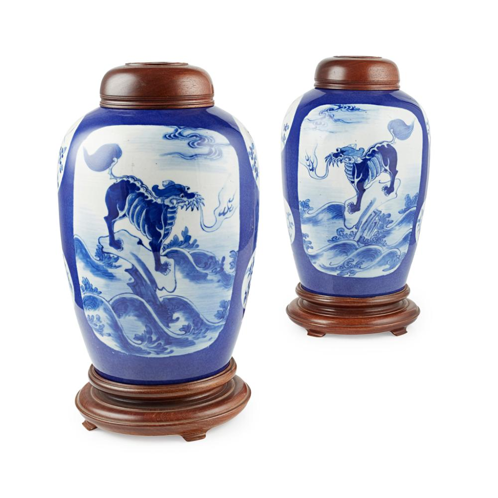 PAIR OF OVOID BLUE-GROUND JARS AND WOODEN COVERS QING DYNASTY, 19TH CENTURY 26cm high (excluding stand)