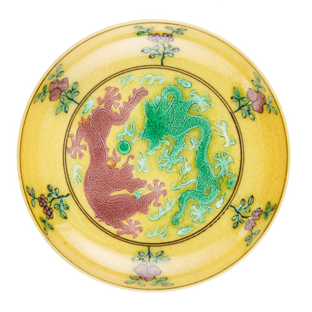 YELLOW-GROUND GREEN AND AUBERGINE-ENAMELLED 'DRAGON' SAUCER QIANLONG MARK, QING DYNASTY 11.1cm diameter