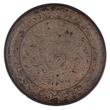 Lot 13: BLACK LACQUER 'NINE DRAGONS' DISH POSSIBLY YUAN DYNASTY 27.8cm diameter