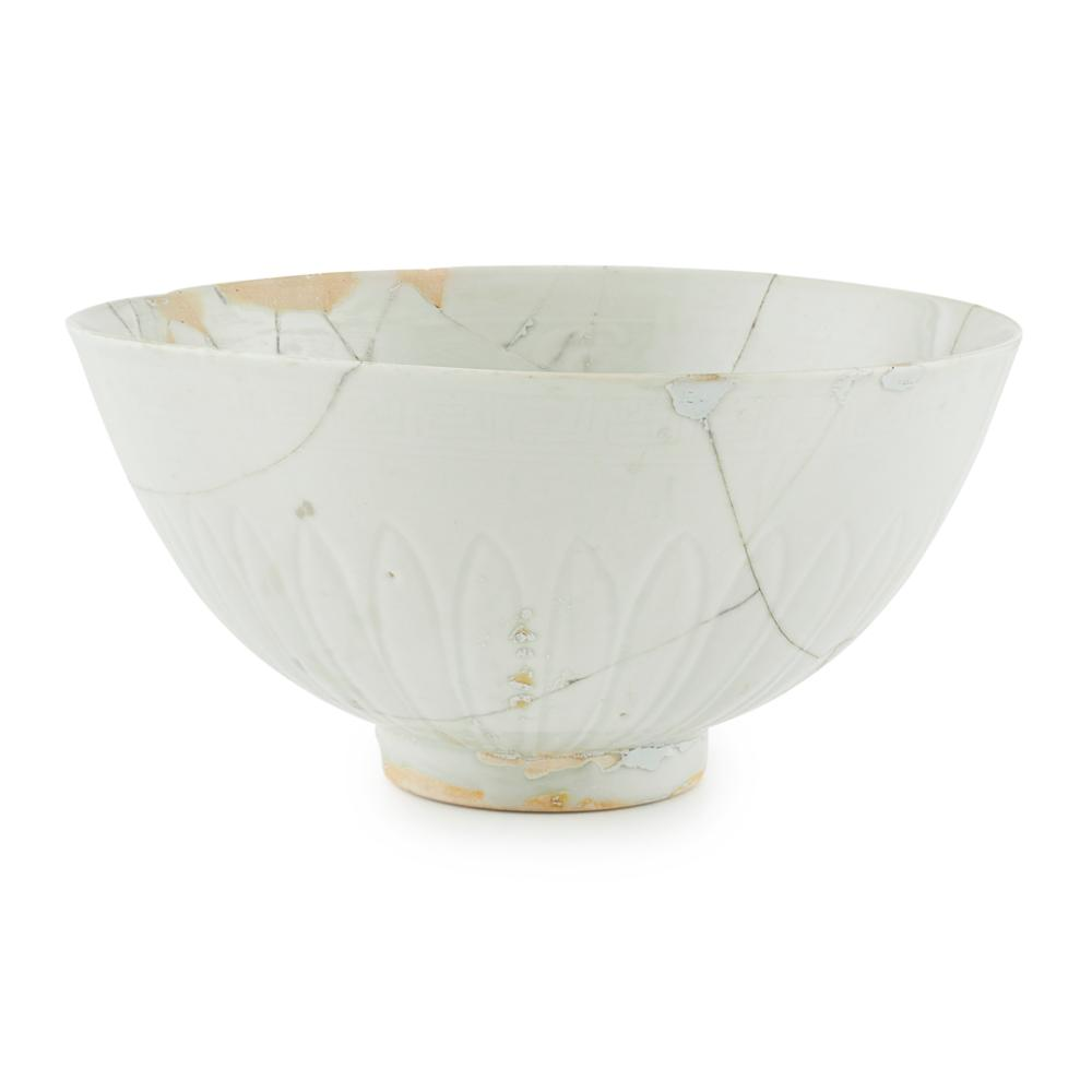 PALE-CELADON-GLAZED AND ANHUA-DECORATED 'LOTUS-SEED CAPSULE' BOWL, LIAN ZI WAN MING STYLE BUT LATER 20.9cm diameter