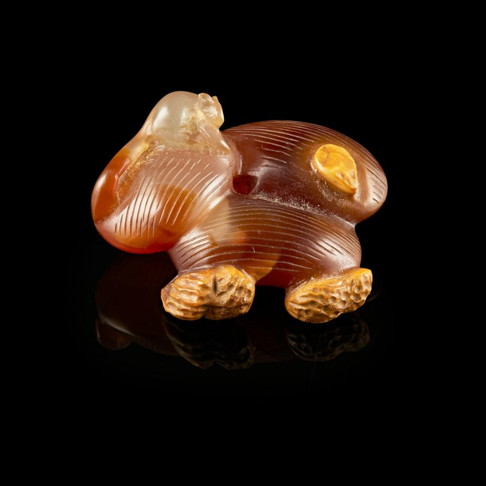 CARVED AGATE 'JUJUBE AND PEANUT' GROUP QING DYNASTY, 19TH CENTURY 4.6cm wide
