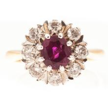 A ruby and diamond cluster ring Ring size: O, estimated total gem weights: ruby 1.16cts, diamonds 0.64cts