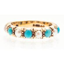 A seed pearl and turquoise set ring Ring size: I/J