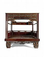 A POLYCHROMED AND GILT FOUR POST BED QING DYANSTY, 19TH CENTURY 248cm wide, 245cm high, 175cm deep