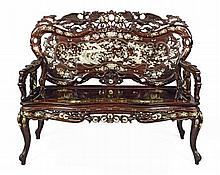 AN IMPRESSIVE HARDWOOD AND MOTHER OF PEARL PARLOUR SUITE QING DYNASTY, LATE 19TH CENTURY Settee 120cm wide, 102cm high, 46cm deep; s...