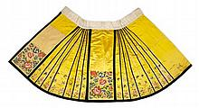 * A YELLOW SILK EMBROIDERED APRON SKIRT QING DYNASTY
