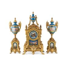 FRENCH GILT METAL AND PORCELAIN MOUNTED CLOCK GARNITURE 19TH CENTURY