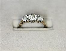 A three stone diamond ring Ring size: L