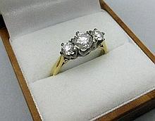 A three stone diamond ring Ring size: N