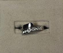 A diamond set cross over ring Ring size: I/J