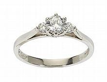 A three stone diamond ring Ring size: N/O, estimated principal diamond weight: 0.56cts