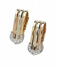 CARTIER - A pair of gold and diamond set earrings 17mm long
