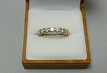 A diamond set full eternity ring Ring size: P
