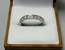 A diamond set eternity ring Ring size: Q