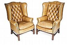 PAIR OF GEORGIAN STYLE LEATHER WING ARMCHAIRS 20TH CENTURY 77cm wide, 112cm high, 56cm deep